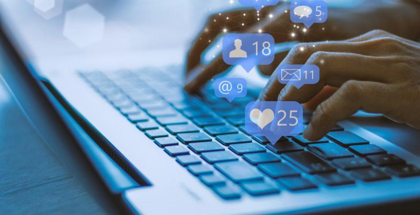 Businesswoman laptop using ,Social, media, Marketing concept / blue tone